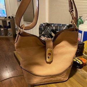 Coach brand leather bucket style nudish/pink bag